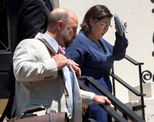 Amanda Kondrat'yev, the woman accused of throwing a drink at U.S. Rep. Matt Gaetz, walks out of the Winston E. Arnow Federal Building in Pensacola on Thursday with her attorney.