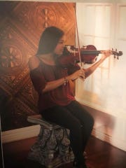 Deleigha Gibson plays a violin.