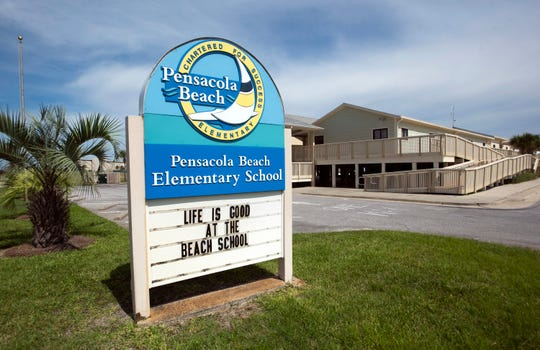 Pensacola Beach Elementary School is suing a former teacher over Facebook posts that the school claims threatened violence, an allegation the woman disputes.