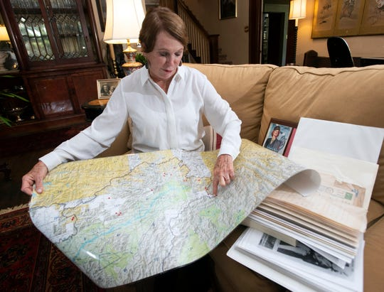 """Ellen Vinson points out on a map the location of the site where Army Air Corps pilot Capt. John """"Blackie"""" Porter crashed in 1943."""