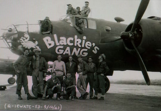 "Army Air Corps pilot Capt. John ""Blackie"" Porter poses with his ""Blackie's Gang"" crew in 1943."