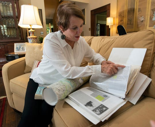 "Ellen Vinson sorts through information she has collected on World War II Army Air Corps pilot Capt. John ""Blackie"" Porter. Porter was married to her mother, and Vinson is working on an effort to recover his remains from a crash site in India."