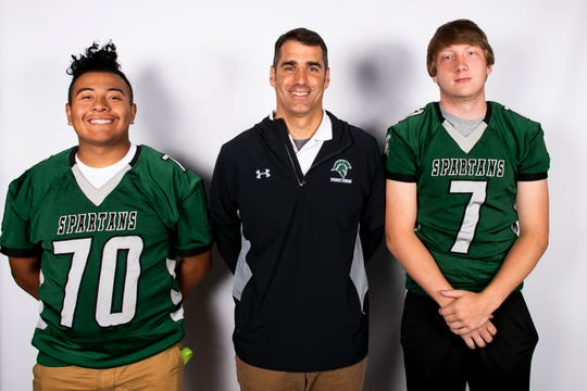 York County Tech football players Luis Ortiz (70) and Ryan Gibson (7) pose with head coach Matt Glennon during YAIAA football media day in Hanover on Thursday, August 1, 2019.