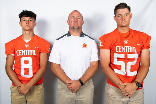 Central York football players Mason Myers (8) and Ian Mcnaughton pose for a photo with head coach Josh Oswalt during YAIAA football media day in Hanover on Thursday, August 1, 2019.