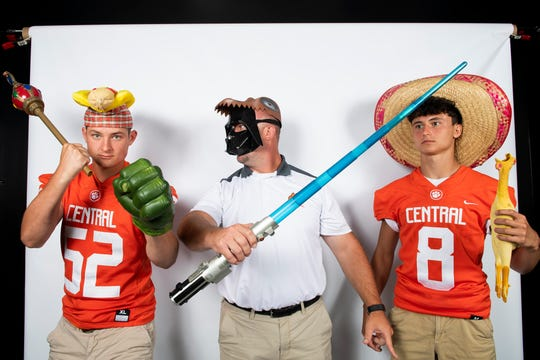 Central York football players Mason Myers (8) and Ian Mcnaughton strike a pose with head coach Josh Oswalt during YAIAA football media day in Hanover on Thursday, August 1, 2019.