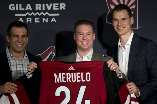 Coyotes President Ahron Cohen (left), owner Alex Meruelo (center), and GM John Chayka (right) speak with the media at a press conference announcing Meruelo's new ownership of the Coyotes at Gila River Arena in Glendale on July 31, 2019.
