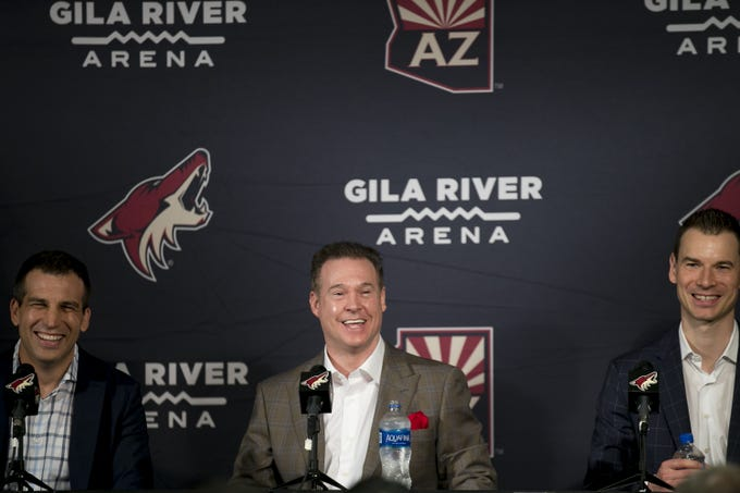 Coyotes President Ahron Cohen (left) owner Alex Meruelo   (center) and GM John Chayka (right) laugh at a press conference announcing Meruelon's new ownership of the Coyotes at Gila River Arena in Glendale, Ariz. on July 31, 2019.