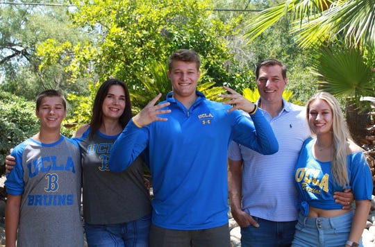 Bruno Fina with members of his family after committing to play football at UCLA
