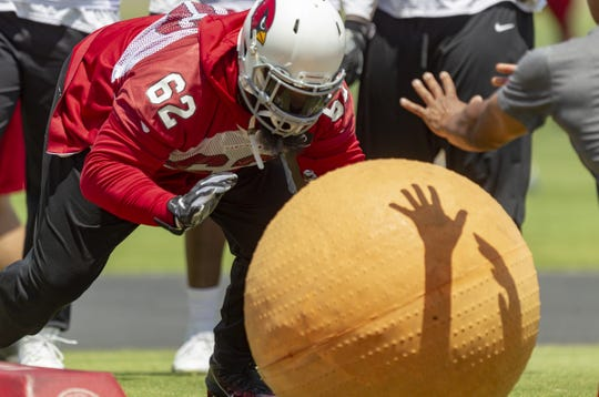 Cardinals defensive lineman Terrell McClain participates in a drill during the second day of a 3-day mandatory minicamp on June 12.