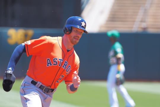 Cedar Crest grad Derek Fisher rounds third base for a run against the Oakland Athletics on Sunday at Oakland Coliseum in Oakland, California. Fisher was traded from the Houston Astros to the Toronto Blue Jays on Wednesday.