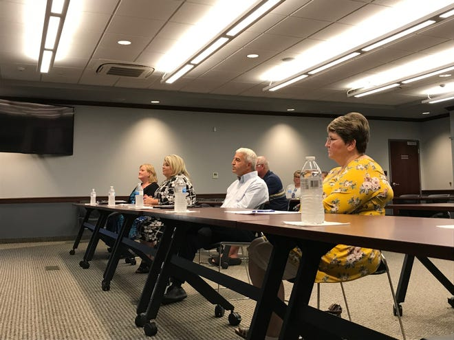 Fort Gratiot residents Lisa Johnson, from left, Jaime Oprita, Tom West and Patricia Bundy interviewed for the vacant treasurer's position in the township on Wednesday, July 31, 2019.