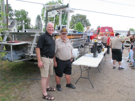 St. Clair County Sheriff Tim Donnellon stands with Dive Chief Wayne Brusate during a fundraiser for the dive team.