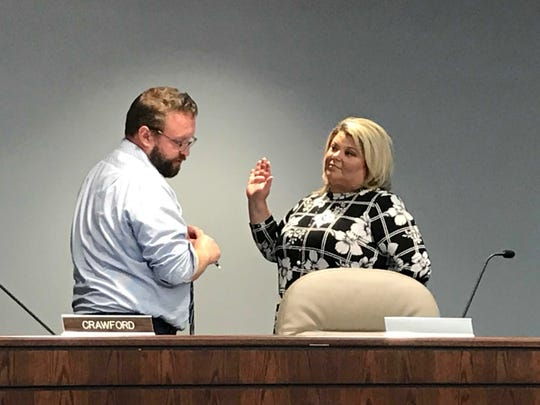 Fort Gratiot Clerk Bob Buechler swears in newly-appointed treasurer, Jaime Oprita during a special meeting on Wednesday, July 31, 2019.