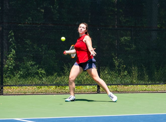 Charlotte Fajardo, from St. Clair High School, returns the ball during a match at the Francis J. Robinson Memorial International Tennis Tournament Thursday, Aug. 1, 2019, at Sanborn Park in Port Huron.