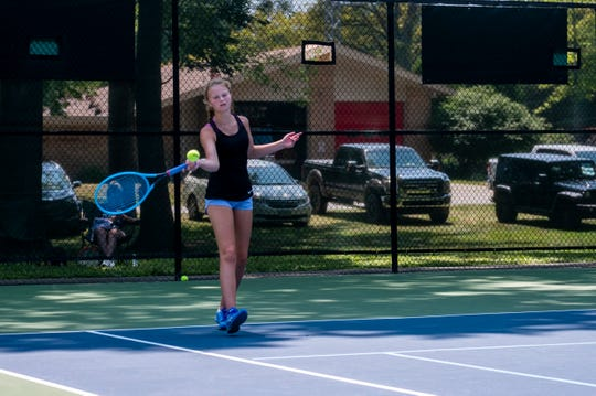 Olivia Ameel, from St. Clair High School, returns a hit during a match at the Francis J. Robinson Memorial International Tennis Tournament Thursday, Aug. 1, 2019, at Sanborn Park in Port Huron.