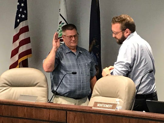 Fort Gratiot Clerk Bob Buechler swears in Rob Crawford, whose vacancy as clerk he filled, as the township's new supervisor on Wednesday, July 31, 2019.