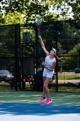 Amolia Rossow, from Fort Gratiot Middle School, serves the ball during a match at the Francis J. Robinson Memorial International Tennis Tournament Thursday, Aug. 1, 2019, at Sanborn Park in Port Huron.