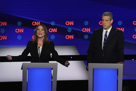 Democratic presidential candidate Marianne Williamson speaks while Rep. Tim Ryan (D-Ohio) listens during the Democratic Presidential Debate at the Fox Theatre in Detroit on Tuesday, July 30, 2019. (Justin Sullivan/Getty Images/TNS) **FOR USE WITH THIS STORY ONLY**