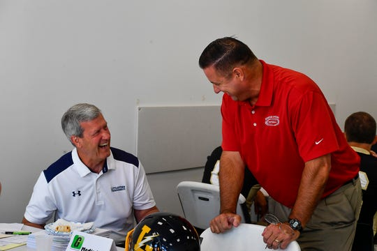 Littlestown coach Mike Lippy, left, and Jon DeFoe of Bermudian Springs share a laugh during Football Media Day, Thursday August 1, 2019.