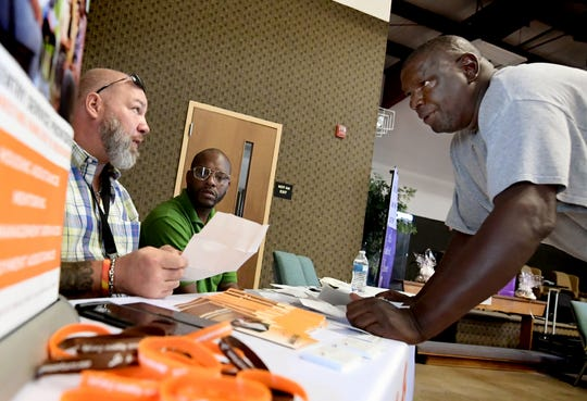 James Greer Sr. of York City, right, talks with A Miracle 4 Sure representatives Brendon Maszon, left, and Greg Carter during a reentry services fair sponsored by the York County Reentry Coalition at the York City Campus of Stillmeadow Church of the Nazarene Thursday, August 1, 2019. Greer was looking for housing during the fair which provided resources for those recently incarcerated. The fair offered support in career training, mental and physical health, legal aid, education, transportation, dealing with disabilities, housing options and other day-to-day needs reentrants encounter. Bill Kalina photo