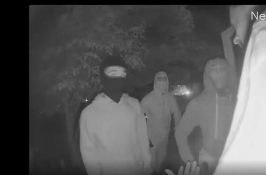 Police are looking to identify three men that held another man at gunpoint during an attempted robbery.