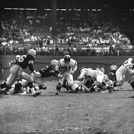 Former York resident George Tarasovic (2) played for the Pittsburgh Steelers for nine years. Here, he is tackling Washington Redskins fullback Don Bossler (31) during an Oct. 5, 1959 game in Pittsburgh. Tarasovic died last month at 89.