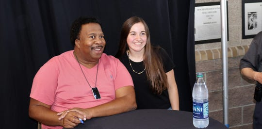 """Office"" star Leslie David Baker poses for a photo with an unidentified fan, one of thousands, during Office Night at Frontier Field on Wednesday, July 31."