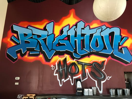 A spray-painted mural by the FUA Krew is featured at the new Brighton Hots at Twelve Corners.