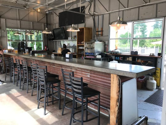 The main bar at The Tap Station, a new bar on Main Street in Independence. Pictured here on July 23, 2019.