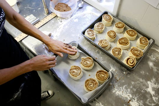 Amanda Nelson places cinnamon roll dough onto baking sheets at Jefferson Bakehouse in Jefferson, Oregon, July 31, 2019.