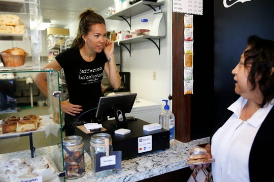 Owner Amanda Nelson (left) speaks with customer Rosa Duran-Perez at Jefferson Bakehouse in Jefferson, Oregon, July 31, 2019.