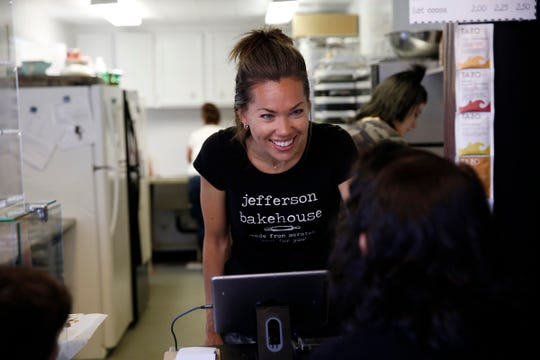 Owner Amanda Nelson speaks with customer Rosa Duran-Perez at Jefferson Bakehouse in Jefferson, Oregon, July 31, 2019.