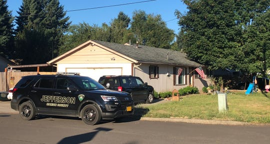 Three people were arrested Thursday morning after authorities discovered meth, heroin and fake prescription pills in a Jefferson house.
