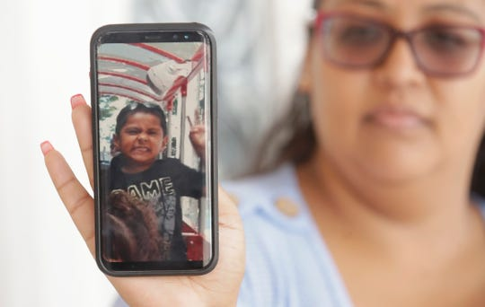 Josephine Guicho holds her phone showing a photo of her 6-year-old nephew Stephen Romero in San Jose, Calif., Monday, July 29, 2019. Romero is one of three young people who died when a gunman opened fire at a popular California food festival this past weekend. (AP Photo/Jeff Chiu)
