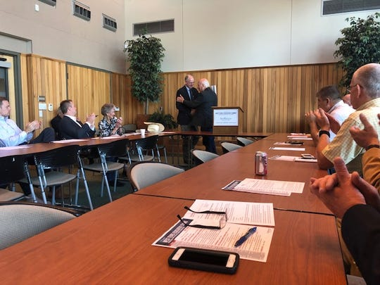 Congressman Mike Conaway shakes Jim Hughes hand as he comes to the panel at a Chamber of Commerce press conference on Thursday, August 8.