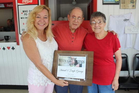 Angie Sellers (left), of the Louisiana Restaurant Association, presents the Louisiana Restaurant Legends Award to Samuel and Dayle George, owners of Deli Casino Sandwich Shoppe in Shreveport.