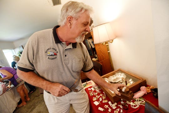 George Hatfield looks at items at one of Magnolia estate sales.