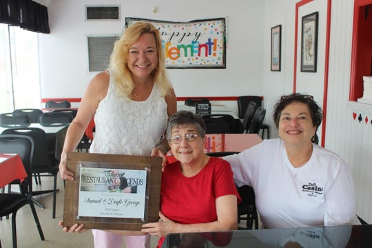 Angie Sellers (left), of the Louisiana Restaurant Association, presents the Louisiana Restaurant Legends Award to Dayle George (center). Also pictured, Carolyn Zenter, sister of Dayle.