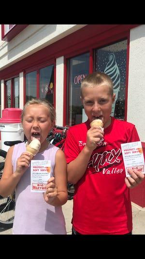 Taetum (left) and Eli Horstmeyer were the recipients of Brandon's new program that rewards kids with ice cream cones for safe behavior.