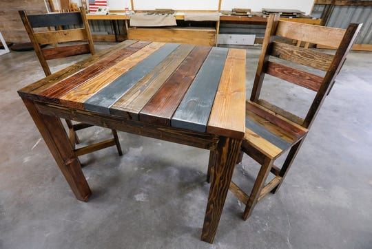 A table and chairs designed by Brittany and Heather Dyer at Beautiful Fight Woodworking.