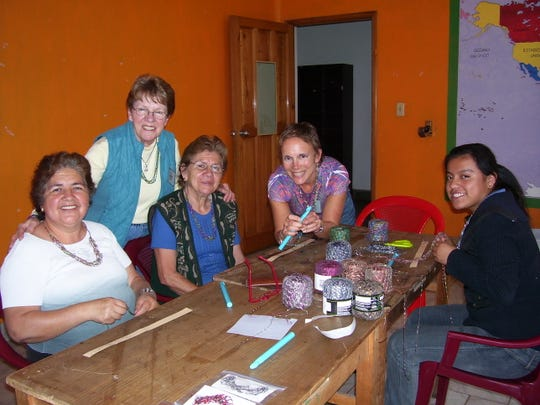 Betty Kampa Miller and Sue Meyer help teach the women in Guatemala how to crochet the Necklaces of Love