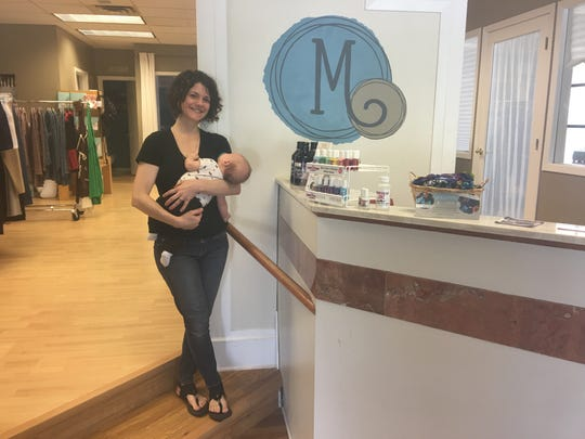 Paula Roufs poses for a photo with her son in her store, For All of Maternity, Thursday, Aug. 1, 2019, after talking about St. Cloud's Big Latch On event.