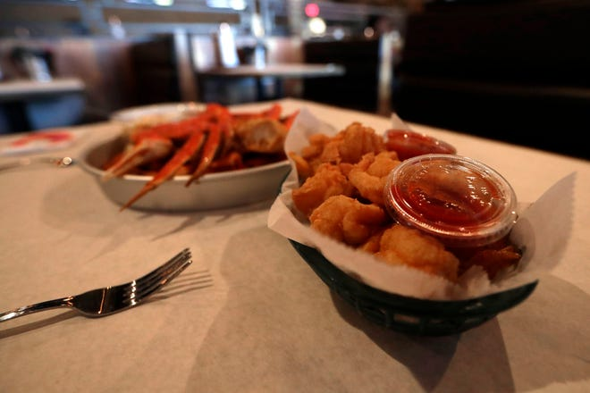 A basket of fried shrimp served with fries and cocktail sauce at Crafty Crab Thursday, Aug. 1, 2019.