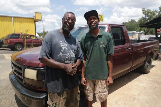 Edwin Barcus, left, started E&J Rolling Rib Shack out of his maroon Ford F-150 with his son, Cederick Davis, right, in the passenger's seat. Now, Barcus and Davis work together at the re-named E&J 5 Buck BBQ's brick and mortar location on South Monroe Street.