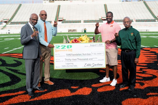 FAMU president Dr. Larry Robinson (left), athletics director Dr. John Eason, football head coach Willie Simmons and 220 Quarterback Club president Eddie Jackson hold the check for $32,000 for a nutritional station. This money was presented to the football program on Thursday, Aug. 1 at Bragg Memorial Stadium.
