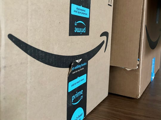 Opened Amazon boxes are pictured in Port St. Lucie on Thursday, Aug. 1, 2019.