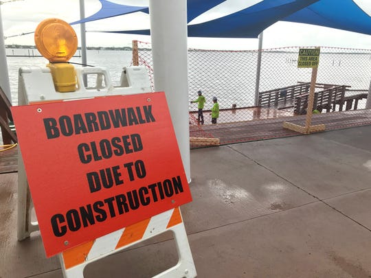 Construction crews repair Stuart's Riverwalk, part of a $523,000 project that is expected to be completed by mid-November.
