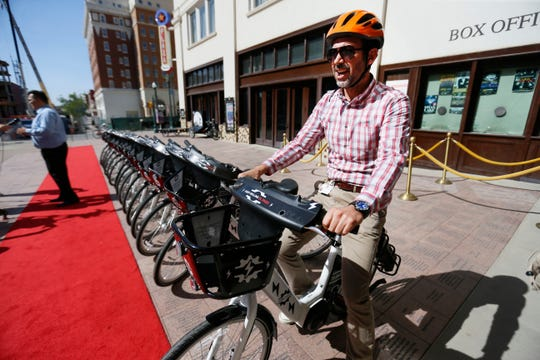 Alfredo Austin, bicycle program coordinator for the City of El Paso, checks out the Camino Real Regional Mobility Authority red-carpet premier for more than a dozen new electric bikes Thursday, Aug. 1, at the Plaza Theater in downtown El Paso. The E-bikes will be available beginning Aug. 1 through its SunCycle Bike Share Program.