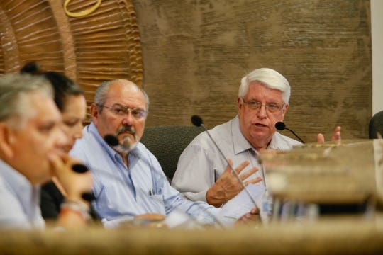 Members of the Building and Standards Commission discuss the Popular Building during a meeting on July 31, 2019.