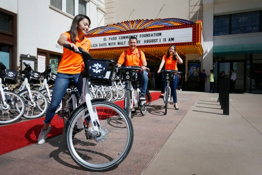 UTEP Center for Transportation Infrastructure Systems students Andrea Jail, Adolfo Cordova and Marketa Vavrova test out bikes during the Camino Real Regional Mobility Authority red-carpet premier for more than a dozen new electric bikes Thursday, Aug. 1, at the Plaza Theater in downtown El Paso. The E-bikes will be available beginning Aug. 1 through its SunCycle Bike Share Program.